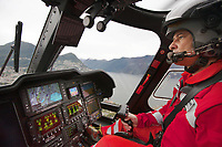 "Switzerland. Canton Ticino. Lugano. Corrado Sasselli is the pilot of a Rega Agusta AW109 SP Grand ""Da Vinci"" helicopter on its way to the nearest suitable hospital, Ospedale Civico. The Rega has rescued an elderly man with a heart problem. All Rega helicopters carry a crew of three: a pilot, an emergency physician, and a paramedic who is also trained to assist the pilot for radio communication, navigation, terrain/object avoidance, and winch operations. The name Rega was created by combining letters from the name ""Swiss Air Rescue Guard"" as it was written in German (Schweizerische Rettungsflugwacht), French (Garde Aérienne Suisse de Sauvetage), and Italian (Guardia Aerea Svizzera di Soccorso). Rega is a private, non-profit air rescue service that provides emergency medical assistance in Switzerland. Rega mainly assists with mountain rescues, though it will also operate in other terrains when needed, most notably during life-threatening emergencies. As a non-profit foundation, Rega does not receive financial assistance from any government. The AgustaWestland AW109 is a lightweight, twin-engine, helicopter built by the Italian manufacturer Leonardo S.p.A. (formerly AgustaWestland, Leonardo-Finmeccanica and Finmeccanica). Leonardo S.p.A is an Italian global high-tech company and one of the key players in aerospace. In close collaboration with the manufacturer, the Da Vinci has been specially designed to cater for Rega's particular requirements as regards carrying out operations in the mountains. It optimally fulfills the high demands made of it in terms of flying characteristics, emergency medical equipment and maintenance. Safety, performance and space have been increased, and maintenance and noise emissions reduced. Lake Lugano (Italian: Lago di Lugano or Ceresio) is a glacial lake which is situated on the border between southern Switzerland and northern Italy. 10.09.2017 © 2017 Didier Ruef"