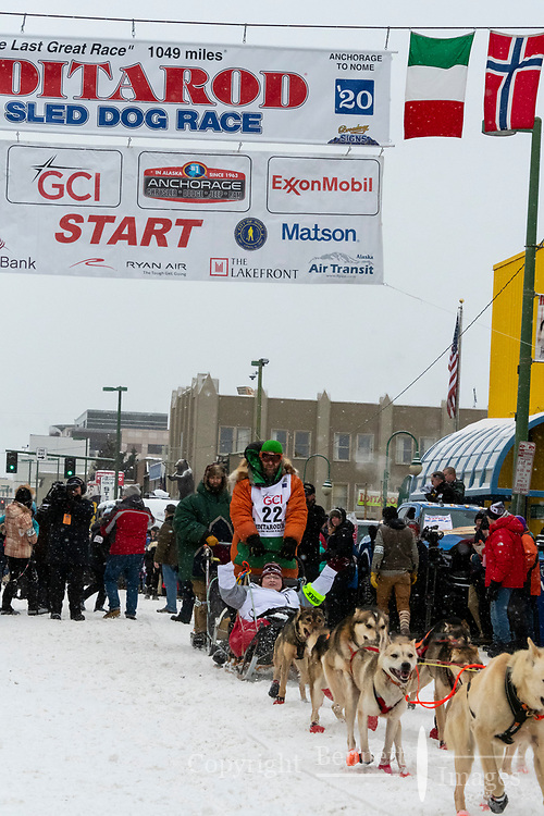 Kelly Maixner and team leave the ceremonial start line with an Iditarider and handler at 4th Avenue and D street in downtown Anchorage, Alaska on Saturday March 7th during the 2020 Iditarod race. Photo copyright by Cathy Hart Photography.com