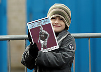 A young Burnley fan waits for the players to arrive at Turf Moor, home of Burnley Football Club<br /> <br /> Photographer Rich Linley/CameraSport<br /> <br /> The Premier League - Burnley v Huddersfield Town - Saturday 6th October 2018 - Turf Moor - Burnley<br /> <br /> World Copyright &copy; 2018 CameraSport. All rights reserved. 43 Linden Ave. Countesthorpe. Leicester. England. LE8 5PG - Tel: +44 (0) 116 277 4147 - admin@camerasport.com - www.camerasport.com