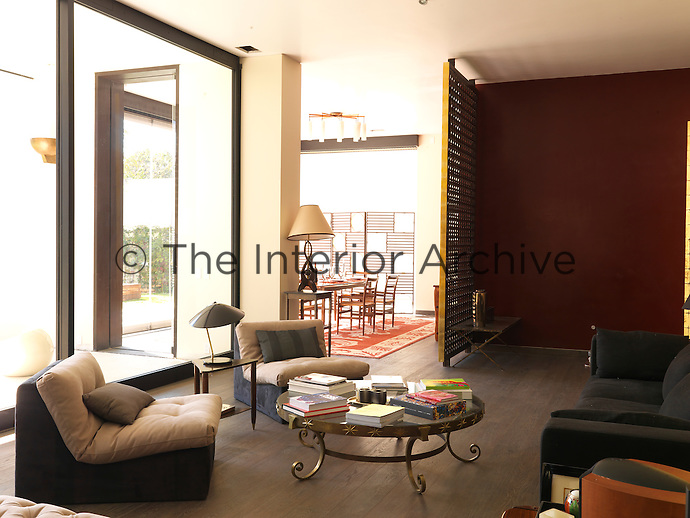 The light and spacious living room is simply furnished with comfortable modern sofa and chairs