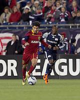 Real Salt Lake defender Tony Beltran (2) dribbles as New England Revolution midfielder Sainey Nyassi (17) closes. In a Major League Soccer (MLS) match, Real Salt Lake defeated the New England Revolution, 2-0, at Gillette Stadium on April 9, 2011.