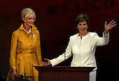 St. Paul, MN - September 1, 2008 -- Mrs. Cindy McCain, wife of United States Senator John McCain, left, is escorted to the podium by first lady Laura Bush, right, as they issued a joint appeal for help to aid affected parts of the Gulf Coast in the aftermath of Hurricane Gustav on day 1 of the 2008 Republican National Convention in Saint Paul, Minnesota on Monday, September 1, 2008..Ron Sachs / CNP.(RESTRICTION: NO New York or New Jersey Newspapers or newspapers within a 75 mile radius of New York City)