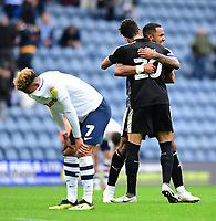Reading's Liam Moore, right, celebrates the win with team-mate Tiago Ilori as Preston North End's Callum Robinson looks away<br /> <br /> Photographer Chris Vaughan/CameraSport<br /> <br /> The EFL Sky Bet Championship - Preston North End v Reading - Saturday 15th September 2018 - Deepdale - Preston<br /> <br /> World Copyright &copy; 2018 CameraSport. All rights reserved. 43 Linden Ave. Countesthorpe. Leicester. England. LE8 5PG - Tel: +44 (0) 116 277 4147 - admin@camerasport.com - www.camerasport.com