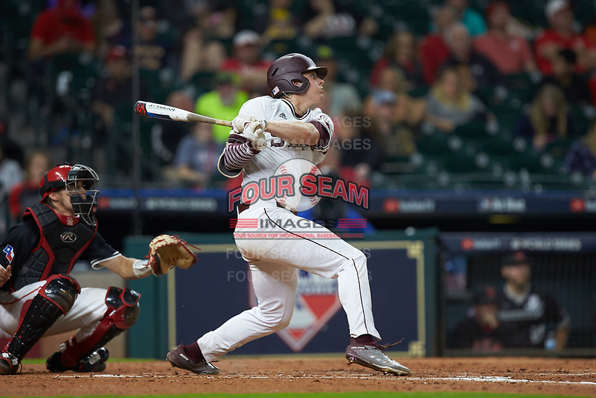 Hunter Vansau (32) of the Mississippi State Bulldogs follows through on his swing against the Houston Cougars in game six of the 2018 Shriners Hospitals for Children College Classic at Minute Maid Park on March 3, 2018 in Houston, Texas. The Bulldogs defeated the Cougars 3-2 in 12 innings. (Brian Westerholt/Four Seam Images)