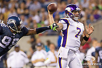 Minnesota Vikings quarterback Christian Ponder (7) has a pass interrupted by Seattle Seahawks defensive end Raheem Brock (98) in the first half at CenturyLink Field in Seattle, Washington.