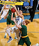 BROOKINGS, SD - JANUARY 6: Macy Miller #12 from South Dakota State University take the ball to the basket past 	Sarah Jacobson #12 from North Dakota State University  during their game Saturday afternoon at Frost Arena in Brookings, SD. (Photo by Dave Eggen/Inertia)