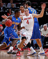 Ohio State Buckeyes guard Aaron Craft (4) gets past a screen while guarding Delaware Blue Hens guard Devon Saddler (10) during the second half of the NCAA men's basketball game at Value City Arena on Wednesday, December 18, 2013. Ohio State beat Delaware, 76-64. (Columbus Dispatch photo by Jonathan Quilter)