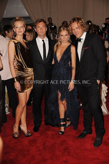 WWW.ACEPIXS.COM . . . . . ....May 3 2010, New York City....Sienna Miller and Jude Law arriving at the Costume Institute Gala Benefit to celebrate the opening of the 'American Woman: Fashioning a National Identity' exhibition at The Metropolitan Museum of Art on May 3, 2010 in New York City.....Please byline: KRISTIN CALLAHAN - ACEPIXS.COM.. . . . . . ..Ace Pictures, Inc:  ..(212) 243-8787 or (646) 679 0430..e-mail: picturedesk@acepixs.com..web: http://www.acepixs.com