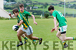 Lios Póil Aaron Ó Muircheartaigh in an action closely watched by Castlegregory Jimmy Grady during the West Kerry Championship game at Lios Póil GAA grounds on Saturday evening.
