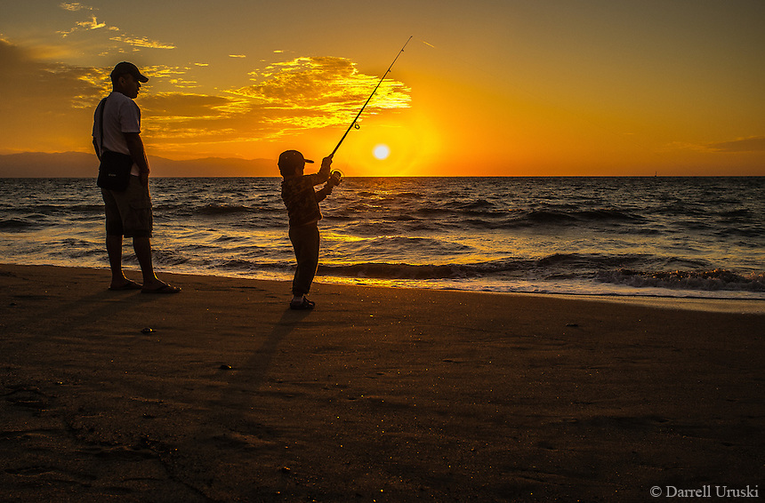Little boy fishing during a golden sunset in mexico for Little boy fishing