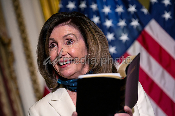 Speaker of the United States House of Representatives Nancy Pelosi (Democrat of California) reads an excerpt from the Bible following a bill enrollment ceremony for the Uyghur Human Rights Policy Act of 2020 at the Untied States Capitol in Washington D.C., U.S., on Tuesday, June 2, 2020.  On Monday, police used tear gas to clear protestors out of Lafayette Square so United States President Donald J. Trump could walk to Saint Johns Episcopal Church.  Credit: Stefani Reynolds / CNP/AdMedia