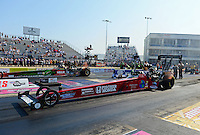 Sept. 21, 2012; Ennis, TX, USA: NHRA top fuel dragster driver Scott Palmer (near lane) races alongside Terry McMillen during qualifying for the Fall Nationals at the Texas Motorplex. Mandatory Credit: Mark J. Rebilas-