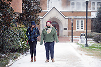 Snow Day on campus - students walking on sidewalk near Perry Cafeteria.<br />  (photo by Megan Bean / &copy; Mississippi State University)