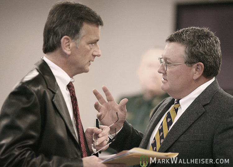 James White, right, the defense attorney for Raymond Hauck talks with defense attorny Waylon Graham, left, the defense attorney for Charles Helms just prior to the arraignment before Judge Michael Overstreet for the eight defendants in the Martin Lee Anderson case at the Bay County Courthouse in Panama City Thursday Jan. 18, 2007.  (Mark Wallheiser/TallahasseeStock.com)
