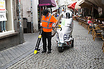Street cleaner using vacuum machine, Maastricht, Limburg province, Netherlands,