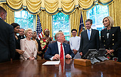 United States President Donald J. Trump speaks as he meets with survivors of religious perception in the Oval Office at the White House in Washington, D.C. on Wednesday, July 17, 2019. <br /> Credit: Kevin Dietsch / Pool via CNP