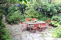 green courtyard<br /> <br /> A building from the 1800's which was turned into a one family house in Greenwich Village in New York City by artist Jane Rosenblaum.