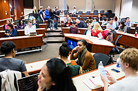 """People gather before New York Assemblyman (79th District) and Vice Chair of the Democratic National Committee Michael Blake speaks to a live audience during a session of Resistance School in the Starr Auditorium in the Belfer Building of Harvard University's John F. Kennedy School of Government, on Thurs., April 27, 2017. Blake's lecture was titled """"How to sustain the resistance long term."""" The lecture, which was the fourth such session and the final in what the group calls the """"first semester"""" of Resistance School, was also streamed live on the internet. Resistance School was started by progressive graduate students at Harvard after the Nov. 8, 2016, election of President Donald Trump. Resistance School describes itself as a """"practical training program that will sharpen the tools [needed] to fight back at the federal, state, and local levels."""" The live lectures are streamed and archived online alongside other information on the Resistance School website. During the lectures, teams of volunteers engage with followers on social media, including Facebook and twitter, sharing soundbytes, quotations, and supplementary materials as the lectures happen."""