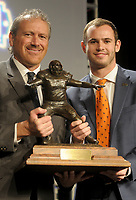 NWA Democrat-Gazette/DAVID GOTTSCHALK Hunter Renfrow (right), wide receiver at Clemson University, stands Monday, December 3, 2018, with the 2018 Burlsworth Trophy with Marty Burlsworth, president and chief executive officer of the Brandon Burlsworth Foundation, at the Northwest Arkansas Convention Center in Springdale. The national award is named after Brandon Burlsworth, a former walk-on at the University of Arkansas, and honors the athletic accomplishments of the walk-on student athlete.