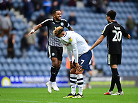 Preston North End's Callum Robinson at the end of the game as Reading's Liam Moore, left, celebrates the win with team-mate Tiago Ilori<br /> <br /> Photographer Chris Vaughan/CameraSport<br /> <br /> The EFL Sky Bet Championship - Preston North End v Reading - Saturday 15th September 2018 - Deepdale - Preston<br /> <br /> World Copyright &copy; 2018 CameraSport. All rights reserved. 43 Linden Ave. Countesthorpe. Leicester. England. LE8 5PG - Tel: +44 (0) 116 277 4147 - admin@camerasport.com - www.camerasport.com