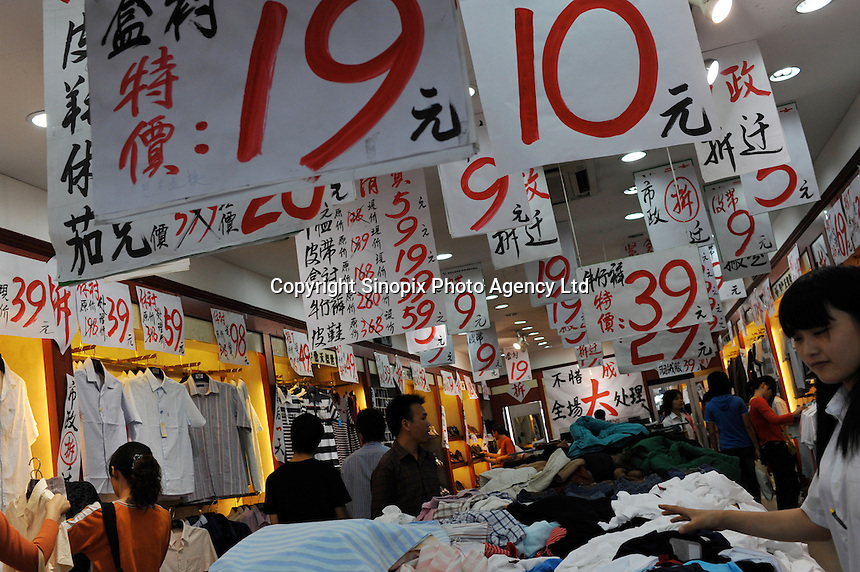 Consumers at a retail store in Foshan, Guangdong Province, China. Despite the general economic down-turn China's domestic demand is helping China to maintain positive economic growth..24 Apr 2009