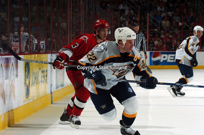 Nashville Predators' Greg Johnson (22) skates ahead of the Carolina Hurricanes' Ray Whitney (13) Friday, January 13, 2006 in Raleigh, NC. Carolina won 5-4 after a shootout.