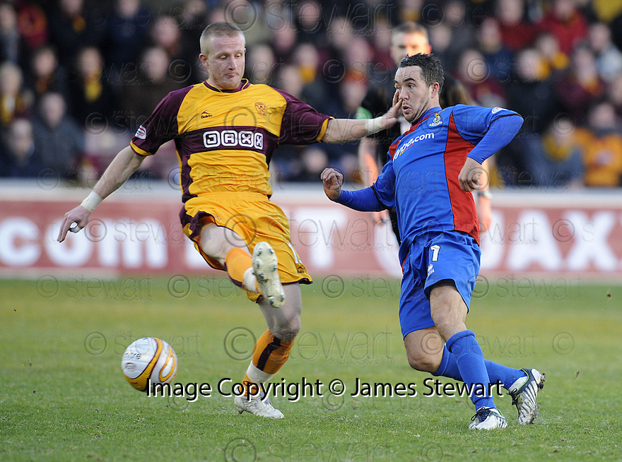 27/12/2008  Copyright Pic: James Stewart.File Name : sct_jspa13_motherwell_v_ICT.MAROS KLIMPL HOLDS OFF DOUGLAS IMRIE.James Stewart Photo Agency 19 Carronlea Drive, Falkirk. FK2 8DN      Vat Reg No. 607 6932 25.Studio      : +44 (0)1324 611191 .Mobile      : +44 (0)7721 416997.E-mail  :  jim@jspa.co.uk.If you require further information then contact Jim Stewart on any of the numbers above.........