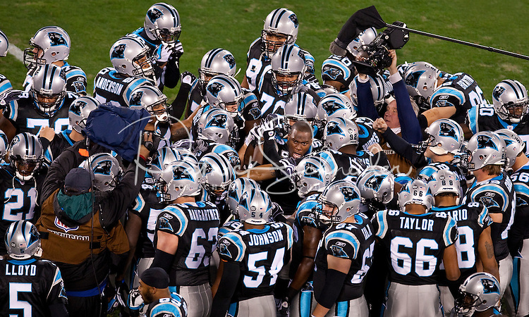 Carolina Panthers huddle before playing the Arizona Cardinals during the NFC Divisional Playoff football game at Bank of America Stadium, in Charlotte, NC. Arizona defeated the Carolina Panthers 33-13.
