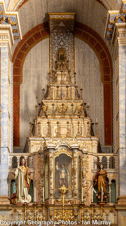 Ornately decorated altar inside the  17th century church of Igreja de Santiago, Tavira, Algarve, Portugal, Southern Europe