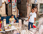 Sampaloc buri weaver Susan Bala welcomes me to her workspace -- the small covered space outside her back door.  Susan's whole family helps her make the buri products we buy and ship to the US.