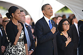 President Barack Obama and First Lady Michelle Obama stand with Irene Hirano Inouye, right, wife of the late U.S. Senator Daniel Inouye (Democrat of Hawaii) as taps is played by a bugler fronting the casket of the late Senator Inouye at the National Memorial Cemetery of the Pacific during ceremonies on Sunday, December 23, 2012. Senator Inouye was a Medal of Honor recipient and a United States Senator since 1963.    .Credit: Cory Lum / Pool via CNP