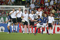 Eddie Lewis attempts a free kick over the wall. The USA lost to Germany 1-0 in the Quarterfinals of the FIFA World Cup 2002 in South Korea on June 21, 2002.