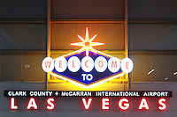 Sign reading Welcome to Las Vegas, Clark County, Terminal 3, McCarran International Airport, Las Vegas, Nevada