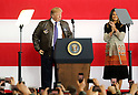 November 5, 2017, Tokyo, Japan - U.S. President Donald Trump wears a flight jacket of the 374th Airlift Wing as he delivers a speech before U.S. soldiers at the Yokota Air Base in Tokyo on Sunday, November 5, 2017. Trump accompanied by his wife Melania arrived here on a three0day official visit to Japan for the first leg of his Asian tour.    (Photo by Yoshio Tsunoda/AFLO) LWX -ytd-