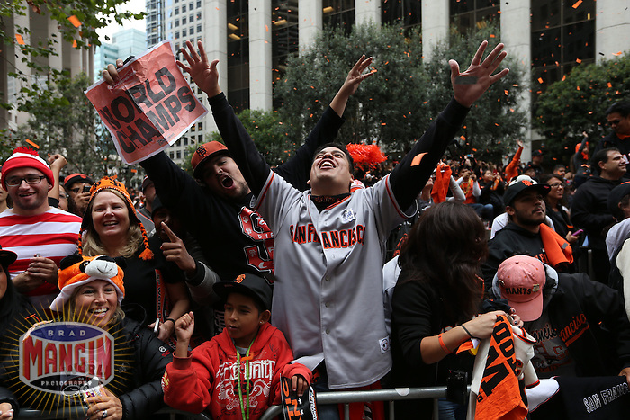 SAN FRANCISCO - OCTOBER 31:  Fans of the San Francisco Giants celebrate on Market Street during the World Series parade on October 31, 2012 in San Francisco, California. (Photo by Brad Mangin)