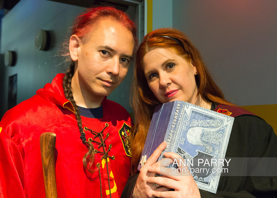 Garden City, New York, U.S. - June 14, 2014 - DAVID LEUNG, from Boston Massachusettes, is dressed as a Hogwarts Gryffindor student, and CHRISTINE EVANS, from NY, NY, is dressed as Lily Evans, Harry Potter's mom as a student, at Eternal Con, the annual Pop Culture Expo, with costumes, Comic Books, Collectibles, Gaming, Sci-Fi, Cosplay, Horror, and held at the Cradle of Aviation Museum on Long Island. Leung and Evans rwere manning the table for The Group That Shall Not Be Named, the New York City Harry Potter MeetUp.