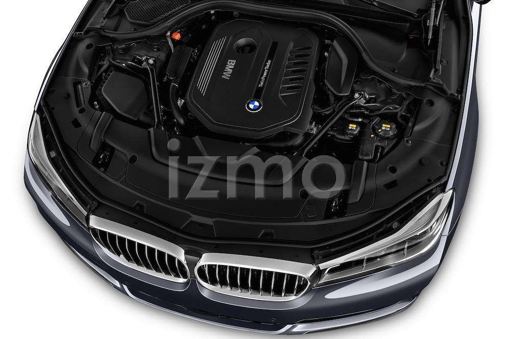 Car Stock 2017 BMW 7 Series 740i 4 Door Sedan Engine  high angle detail view