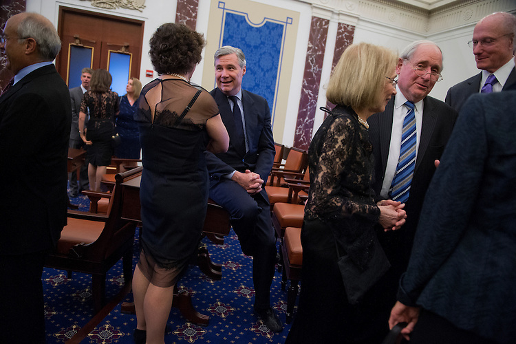 UNITED STATES - MARCH 29: Sens. Sheldon Whitehouse, D-R.I., center, and Carl Levin, D-Mich., second from right, hang out in a life-size replica of the Senate Chamber during a gala that was part of the dedication ceremony for the Edward M. Kennedy Institute in Boston, Mass., March 29, 2015. (Photo By Tom Williams/CQ Roll Call)