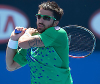 JANKO TIPSAREVIC (SRB) against JAMES DUCKWORTH (AUS) in the second round of the Men's Singles. Janko Tipsarevic beat James Duckworth 3-6 6-2 7-6 6-4..19/01/2012, 19th January 2012, 19.01.2012..The Australian Open, Melbourne Park, Melbourne,Victoria, Australia.@AMN IMAGES, Frey, Advantage Media Network, 30, Cleveland Street, London, W1T 4JD .Tel - +44 208 947 0100..email - mfrey@advantagemedianet.com..www.amnimages.photoshelter.com.