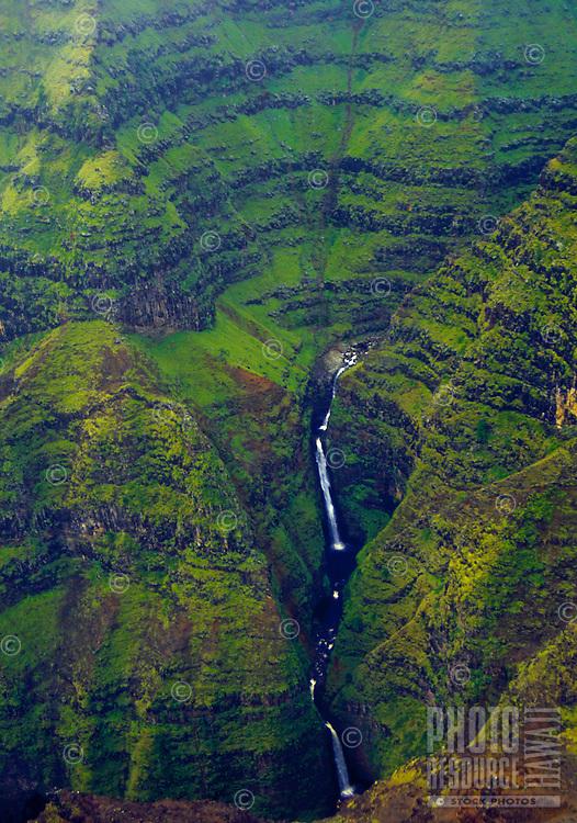 Aerial of waterfall in a deep gorge of Waimea Canyon, island of Kauai