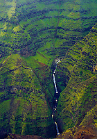 Aerial of waterfall in a deep gorge of Waimea Canyon, island of Kauai