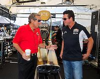 Oct 15, 2016; Ennis, TX, USA; Papa Johns Pizza owner John Schnatter (right) talks with NHRA team owner Don Schumacher during the Fall Nationals at Texas Motorplex. Mandatory Credit: Mark J. Rebilas-USA TODAY Sports