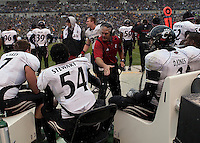 An assistant coach barks out instructions on the Cincinnati Bearcats bench. The Cincinnati Bearcats defeated the Pittsburgh Panthers 45-44 in the final seconds of the River City Rivalry in a contest for the Big East Championship and a major bowl bid on December 5, 2009 at Heinz Field, Pittsburgh, Pennsylvania. .