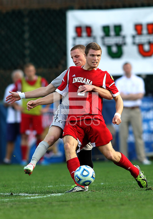 HOOVER, AL - DECEMBER 09, 2012: Eriq Zavaleta (2) of Indiana Universityis held by Tommy Muller (8) of Georgetown University during the NCAA 2012 Men's College Cup championship, at Regions Park, in Hoover , AL, on Sunday, December 09, 2012.