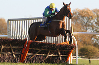 Our Ollie ridden by Tom O'Brien in jumping action during the Hempton National Hunt Maiden Hurdle