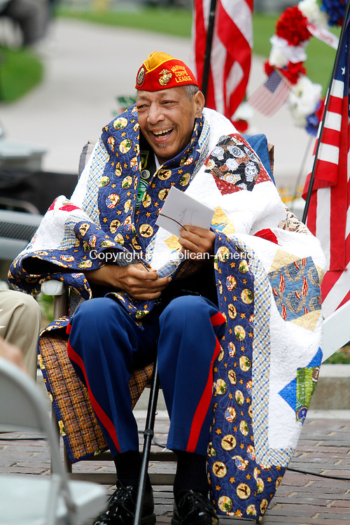 WATERBURY, CT - 29 JULY 2017 - 072917JW05.jpg -- Samuel K. Beamon reacts as he sits with his new quilt honoring his service given to him for his birthday by Rep. Elizabeth H. Esty, D-5th District and Quilts of Valor Foundation Co-coordinator Jane Dougherty during the Korean War Remembrance Day Ceremony Saturday morning on the Waterbury Green.  Jonathan Wilcox Republican-American