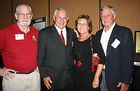 NWA Democrat-Gazette/CARIN SCHOPPMEYER Cliff Powell (from left), Ken and Cyndy Hatfield and Billy Joe Moody help support the Razorback Foundation at the Sports Hall of Honor banquet.