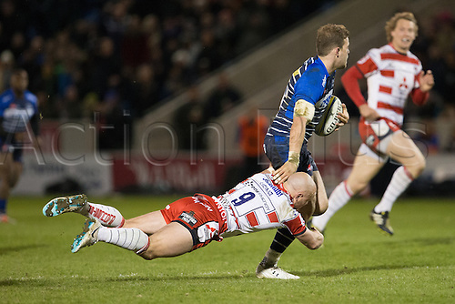 29.04.2016. AJ Bell Stadium, Salford, England. Aviva Premiership Sale Sharks versus Gloucester Rugby. Sale Sharks centre Will Addison is tackled by Gloucester Rugby scrum half Willi Heinz.
