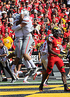 Ohio State Buckeyes running back Jalin Marshall (17) hugs Ohio State Buckeyes tight end Jeff Heuerman (5) in celebration of his touchdown  in the first  quarter of their game at Byrd Stadium in College Park, Maryland on October 4, 2014. (Columbus Dispatch photo by Brooke LaValley)