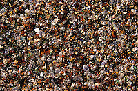 close up of Glass beach sand, 1992 hurricane swept bottling site to sea, polished bits return with each tide, island of Kauai